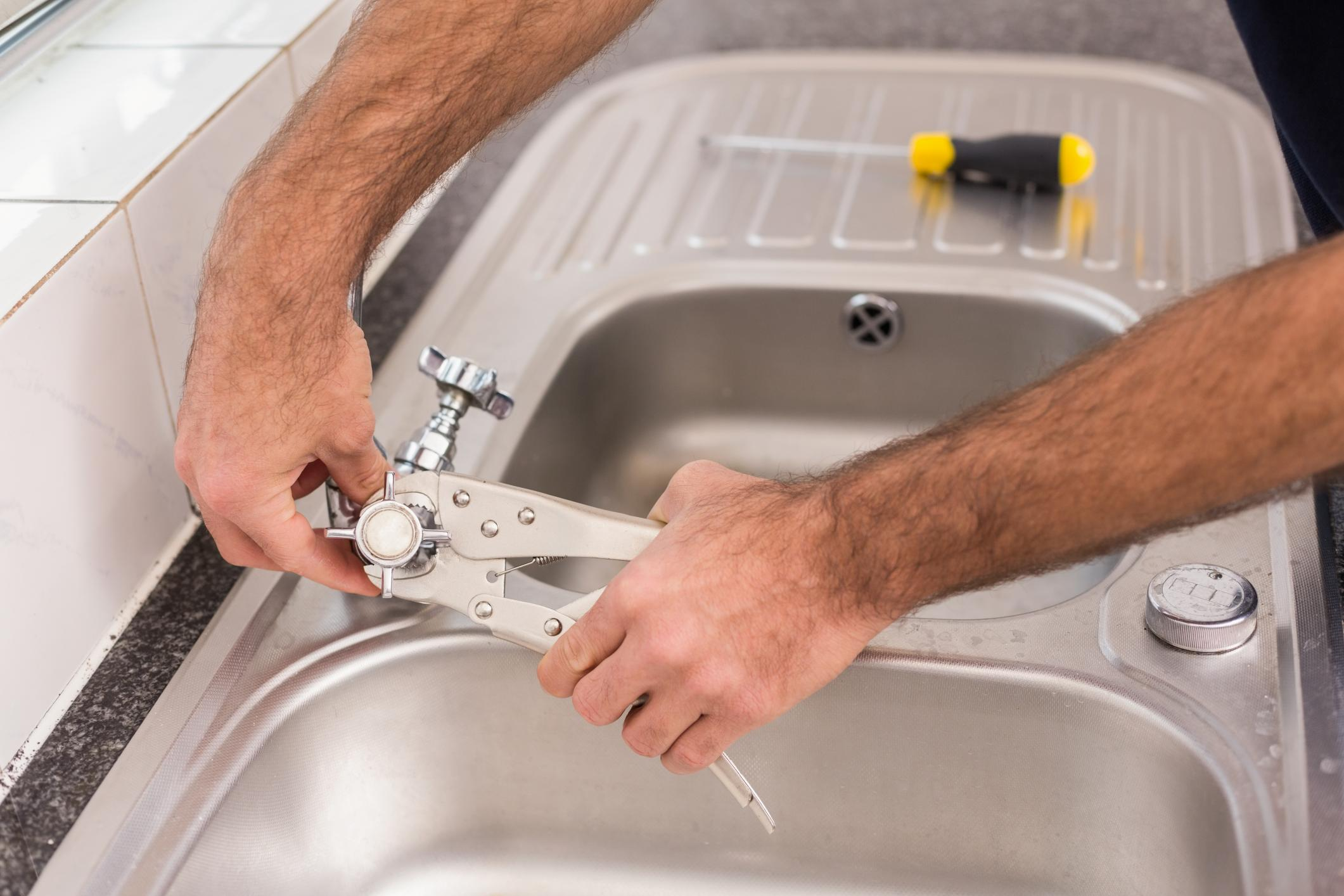 Kitchen Faucet Service & Repair - Raleigh Plumbers | Golden Rule ...